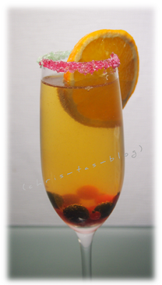 Sektglas mit buntem Zuckerrand