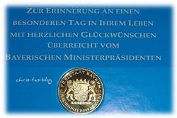 Glückwünsche und Münze vom Bayerischen Ministerpräsidenten